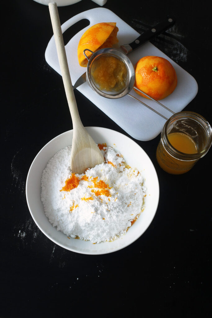 mixing sugar, zest, and juice