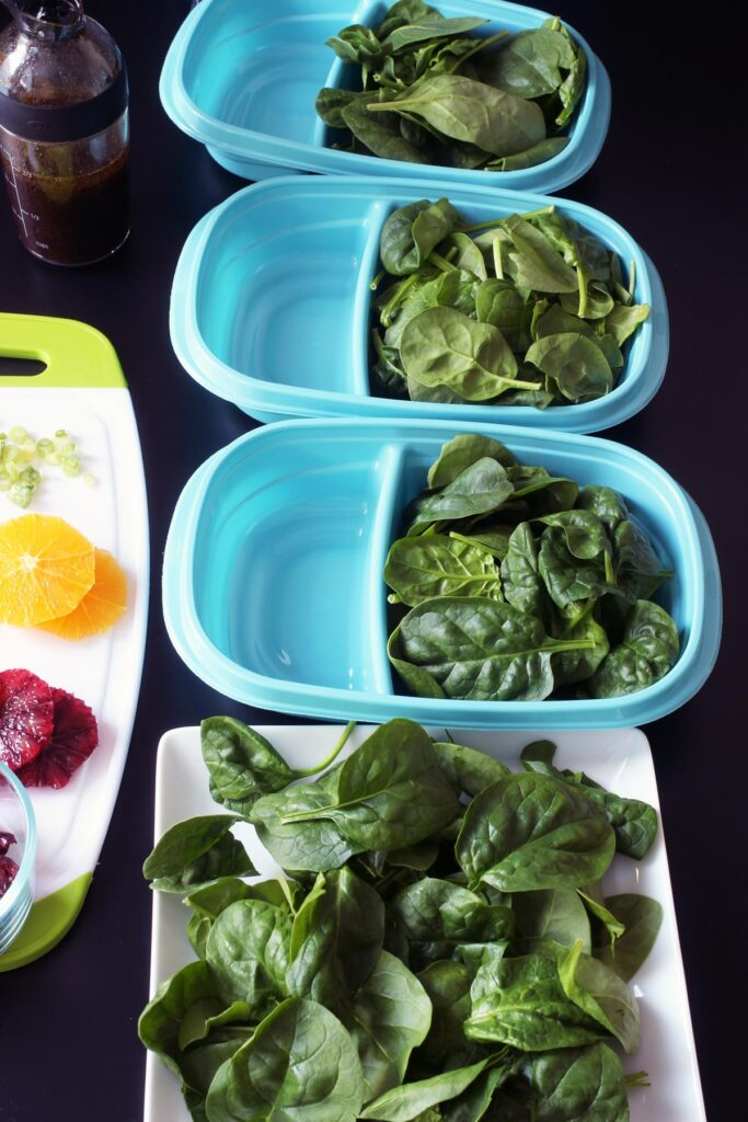 spinach divided into four salads