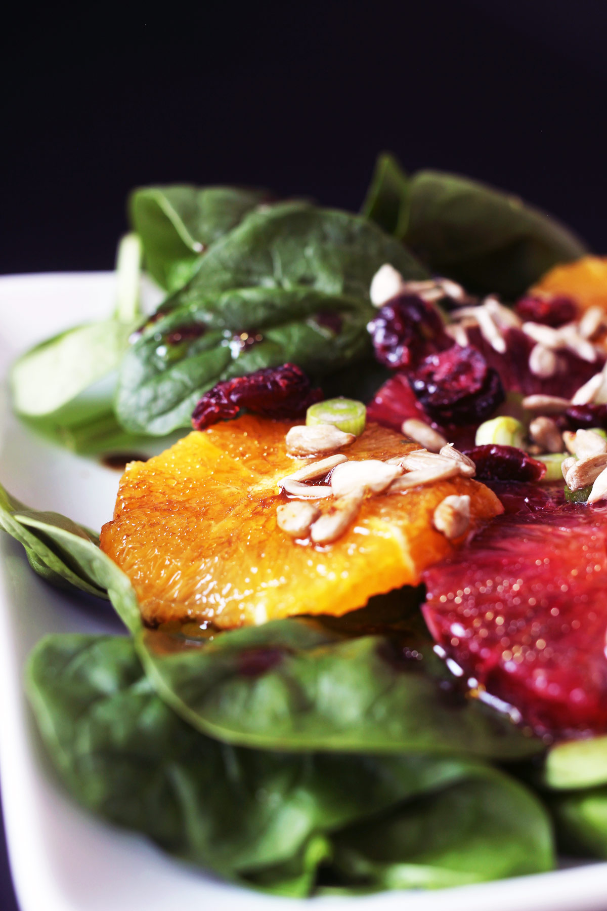 close-up of oranges on spinach salad