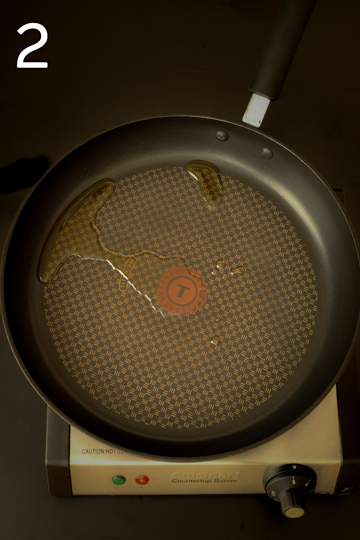 heating the oil in a skillet.
