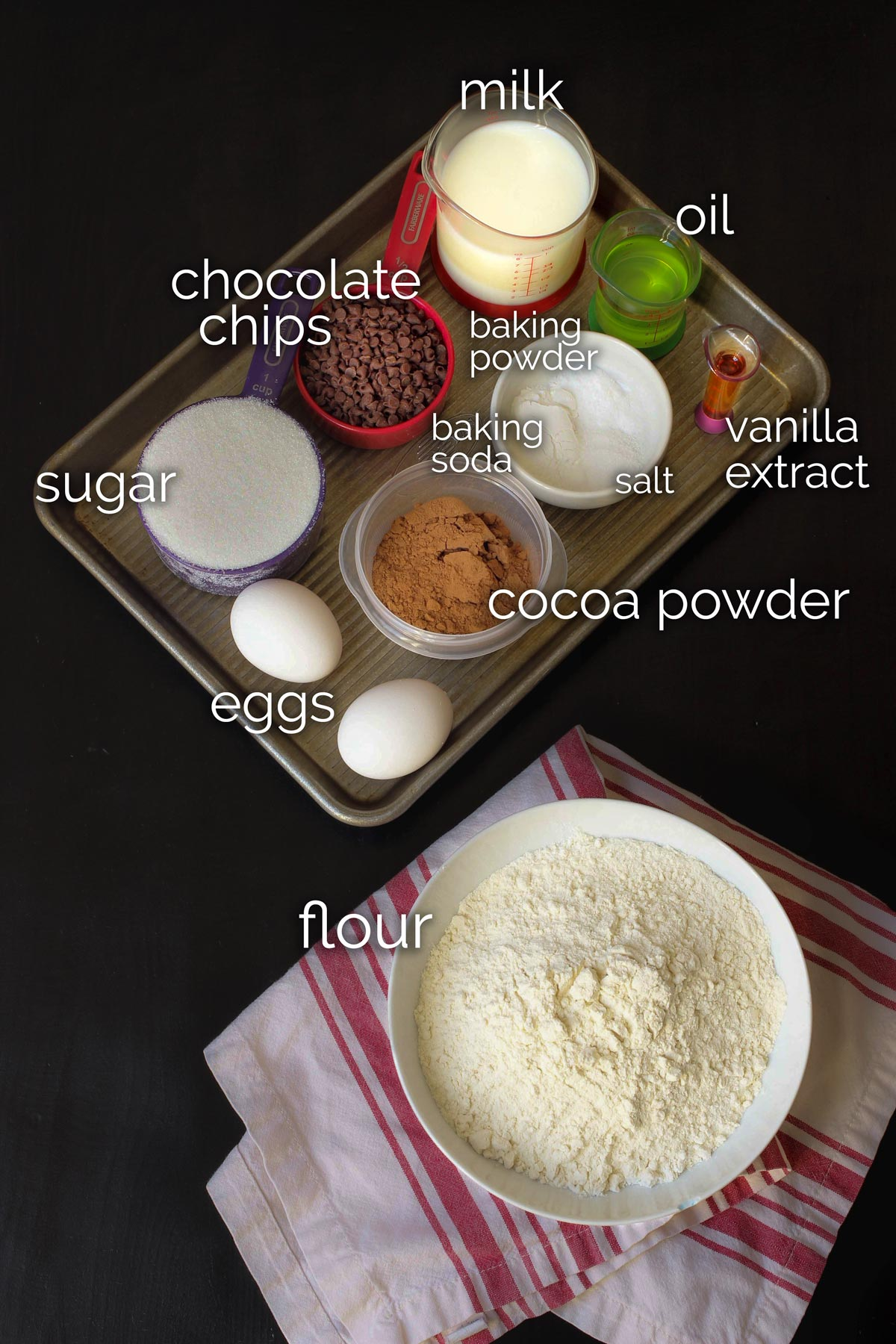 ingredients for chocolate donuts laid out on the table top.