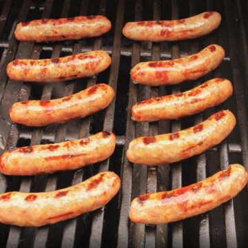 ten grilled brats ready on the grill.
