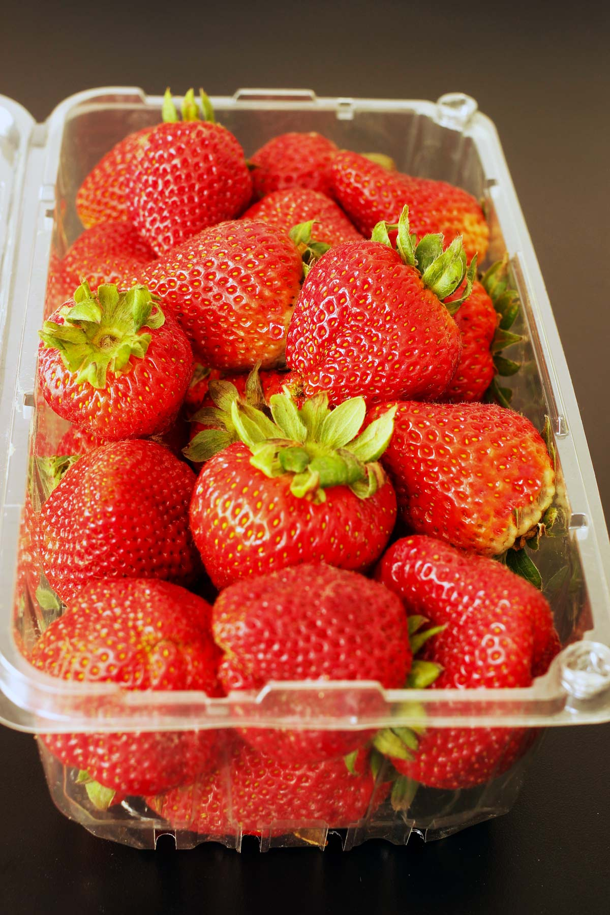strawberries in plastic clamshell box.