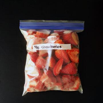 ziptop freezer bag of frozen strawberries.