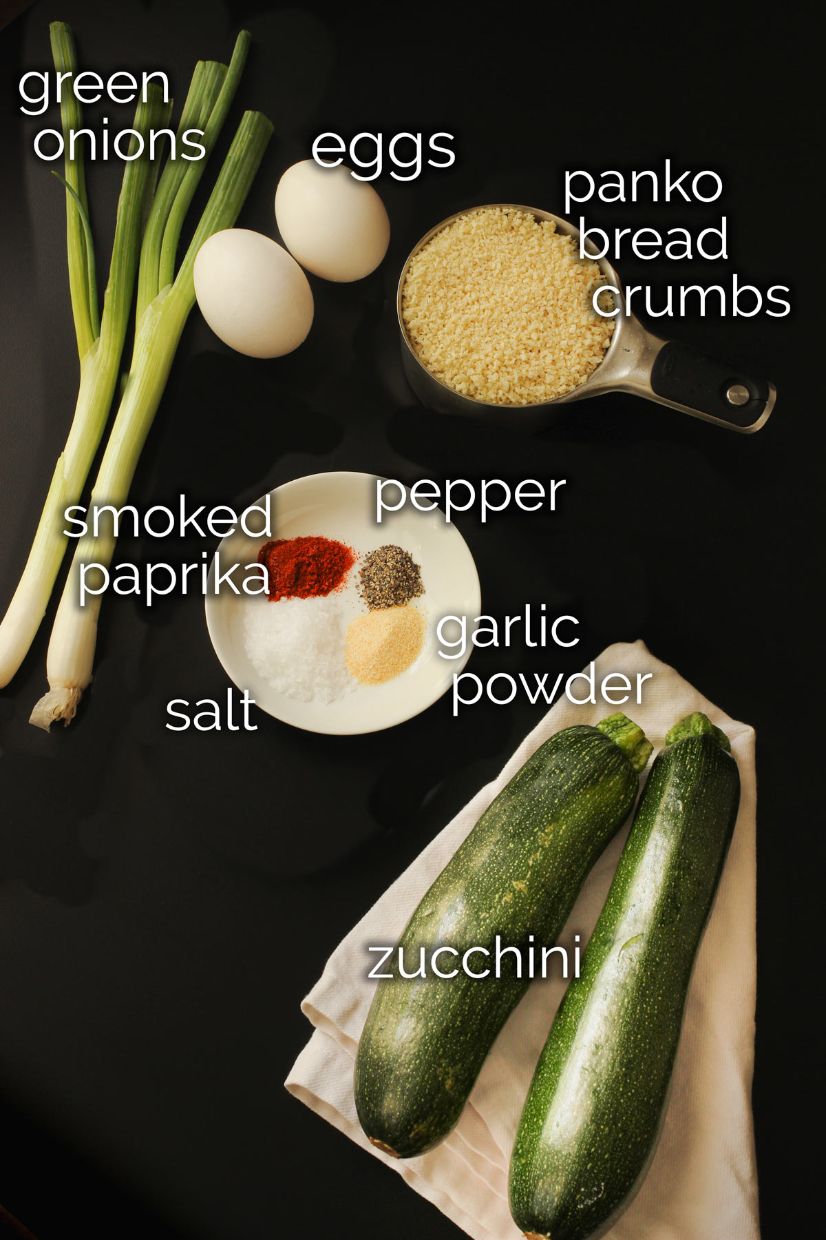 ingredients for baked zucchini fritters laid out on the tabletop.