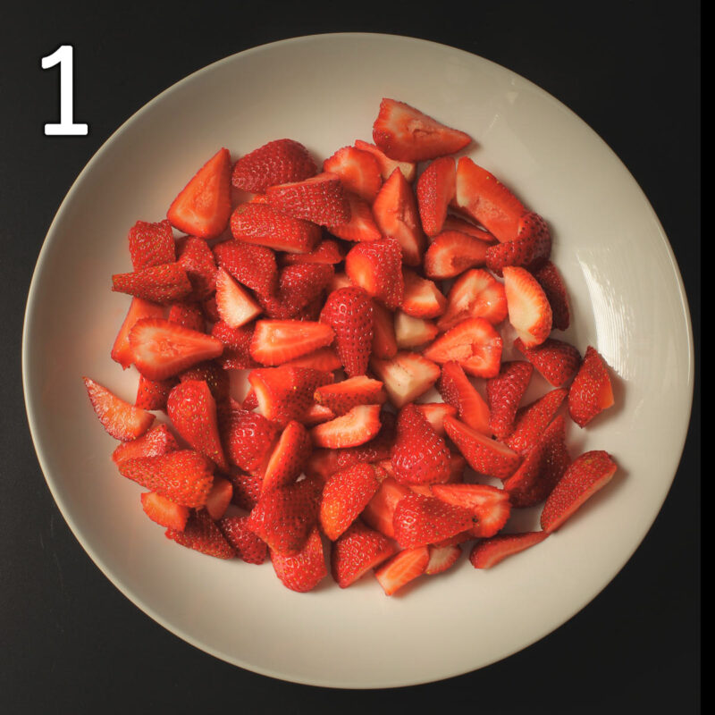 layer of strawberries in large round white platter.