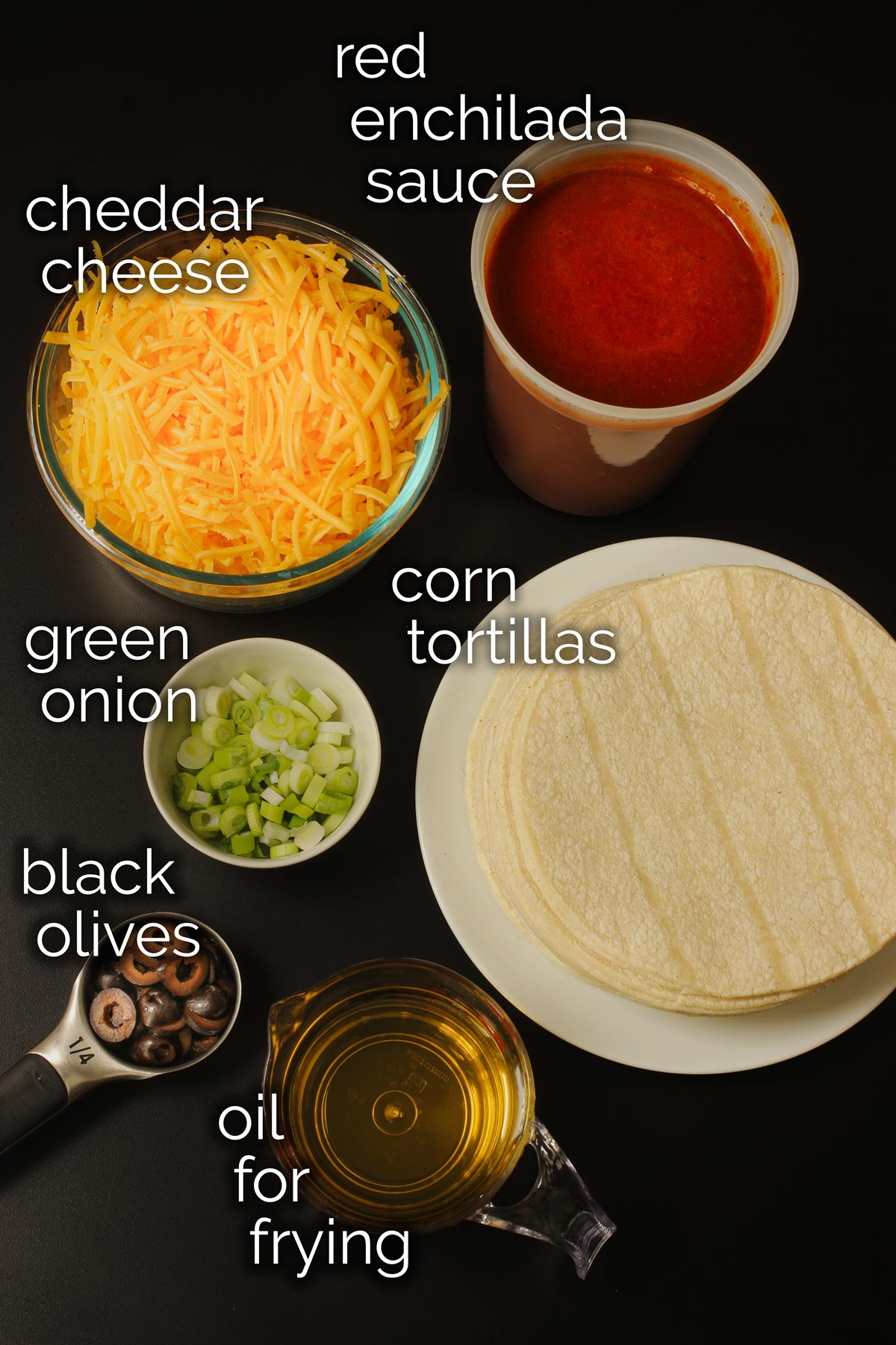 ingredients for cheese enchiladas laid out on table.