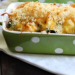 single serve green rectangle dish with chicken divan topped with breadcrumbs.