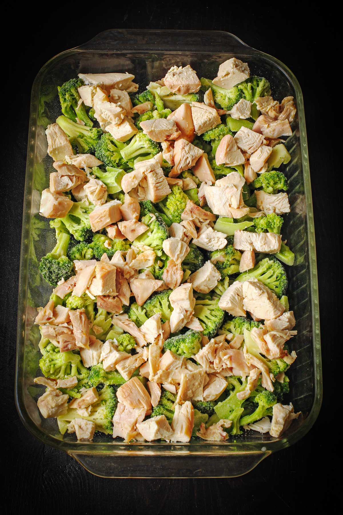 layer of cooked and cubed chicken atop the layer of broccoli.