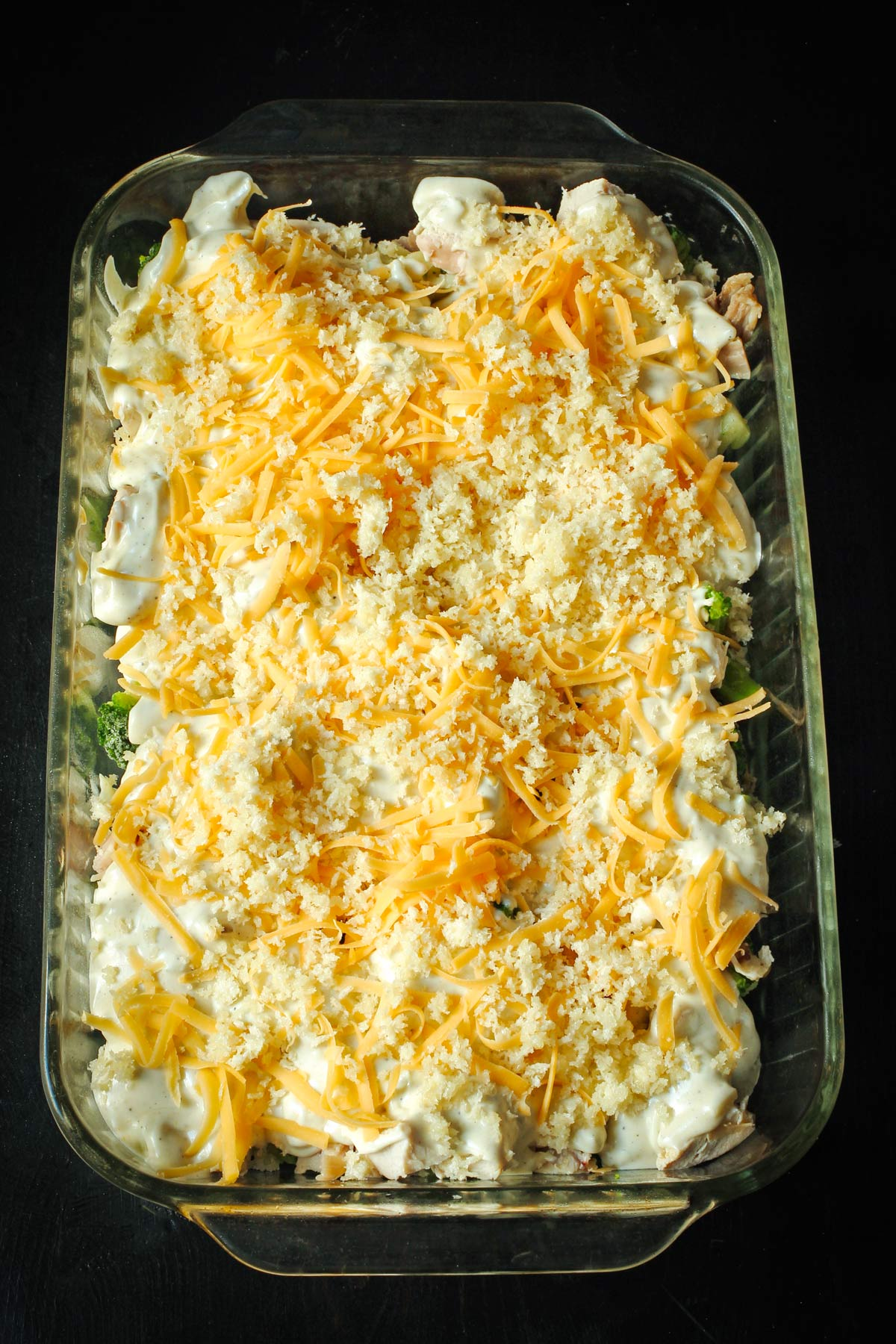 buttered breadcrumbs scattered over the cheese layer on the casserole.
