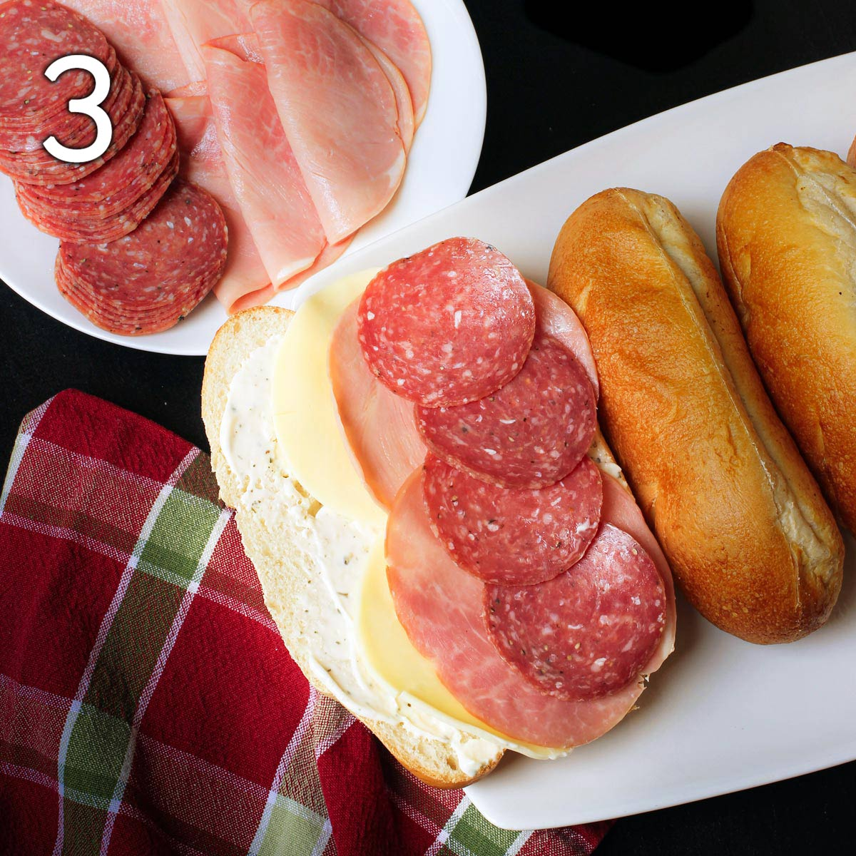 Italian cold cuts layered on provolone on sub roll.
