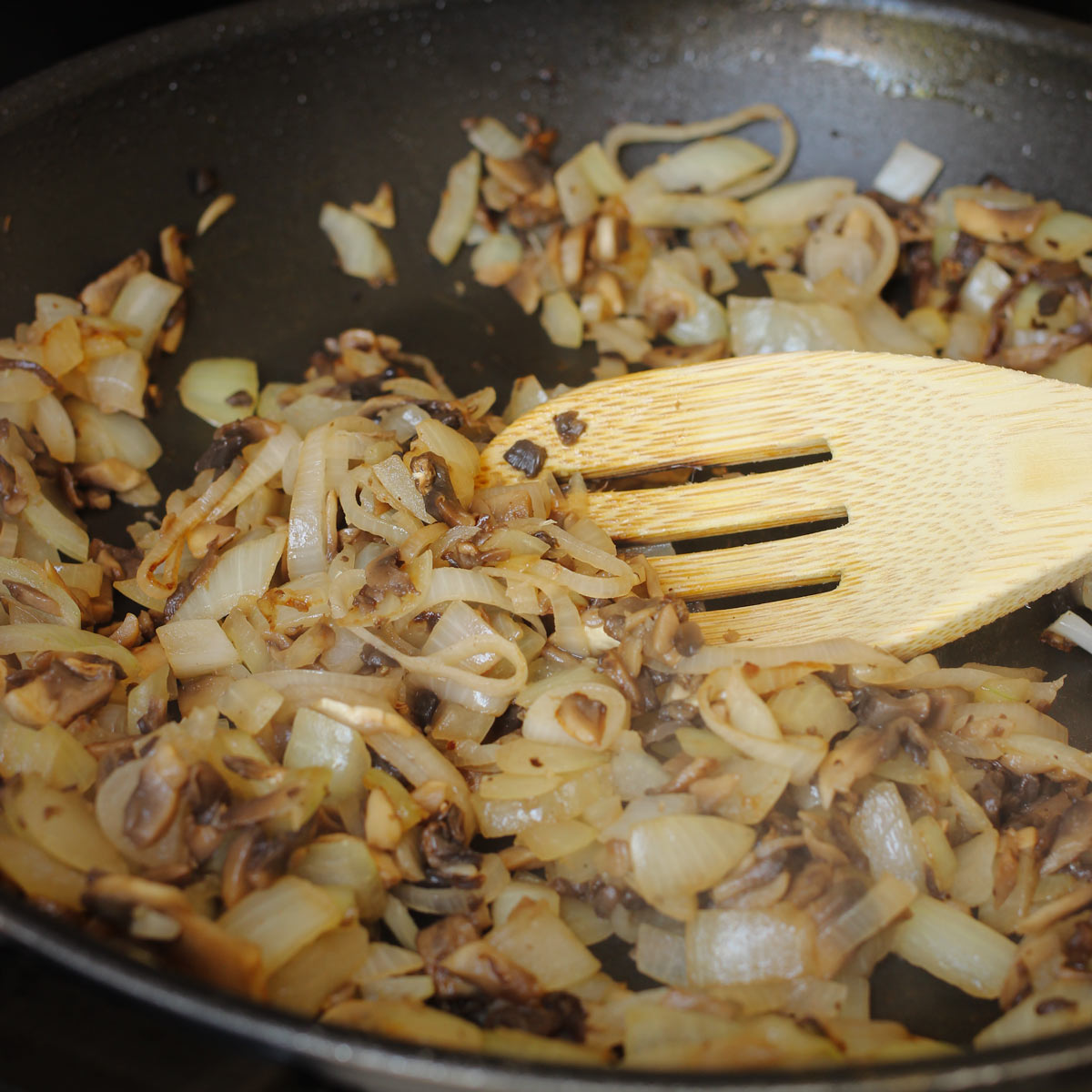 sauteed onions, shallots, and mushrooms in skillet.