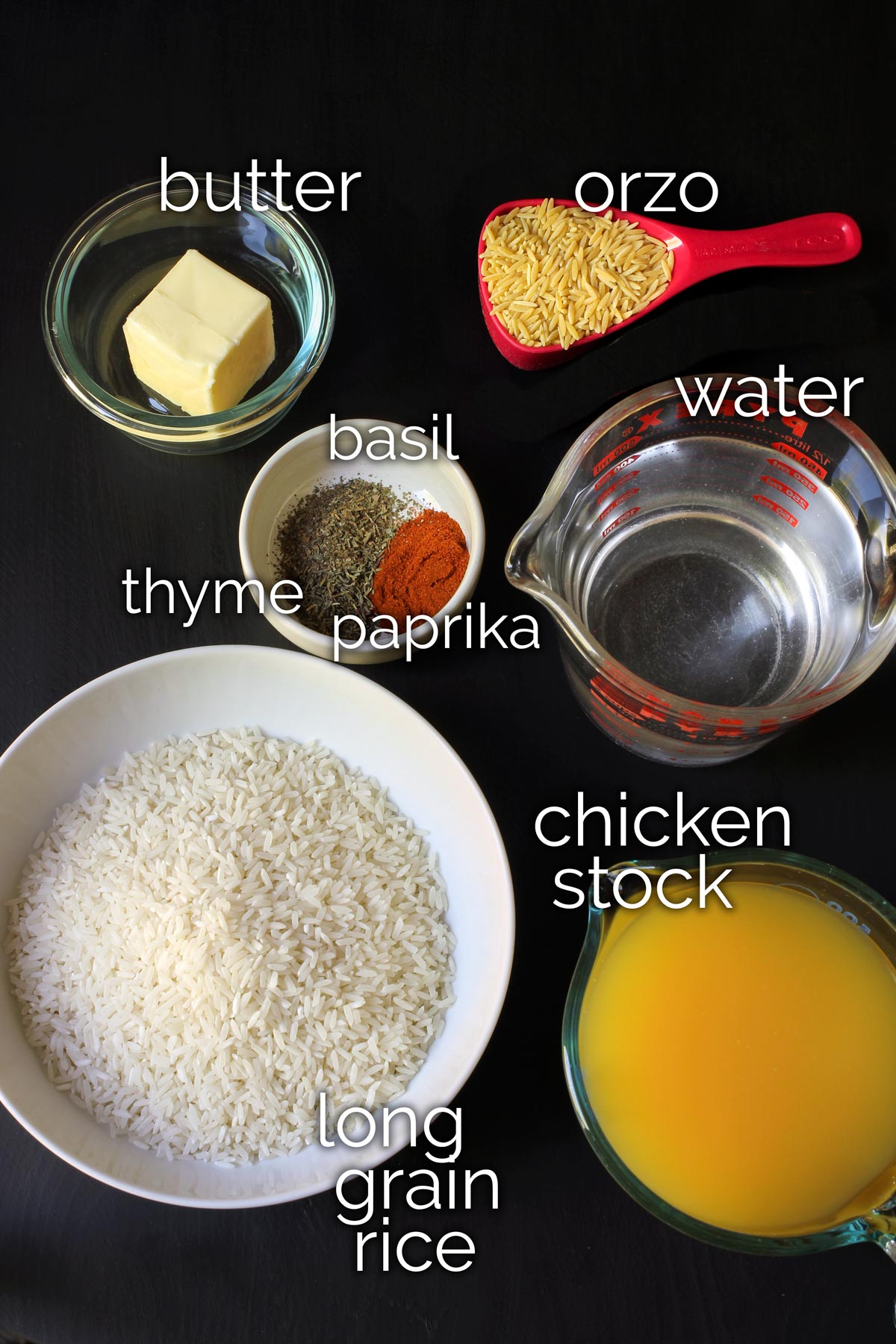 ingredients for seasoned rice pilaf on tabletop.