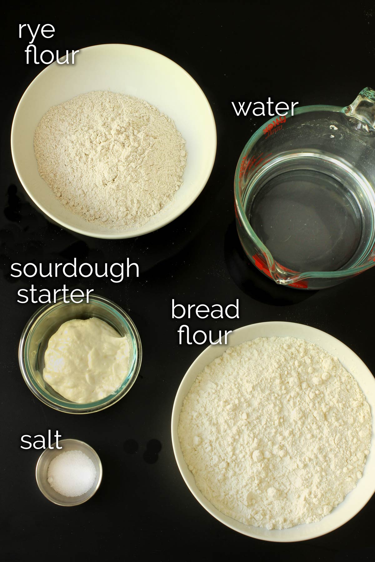 ingredients for sourdough rye bread laid out on tabletop.