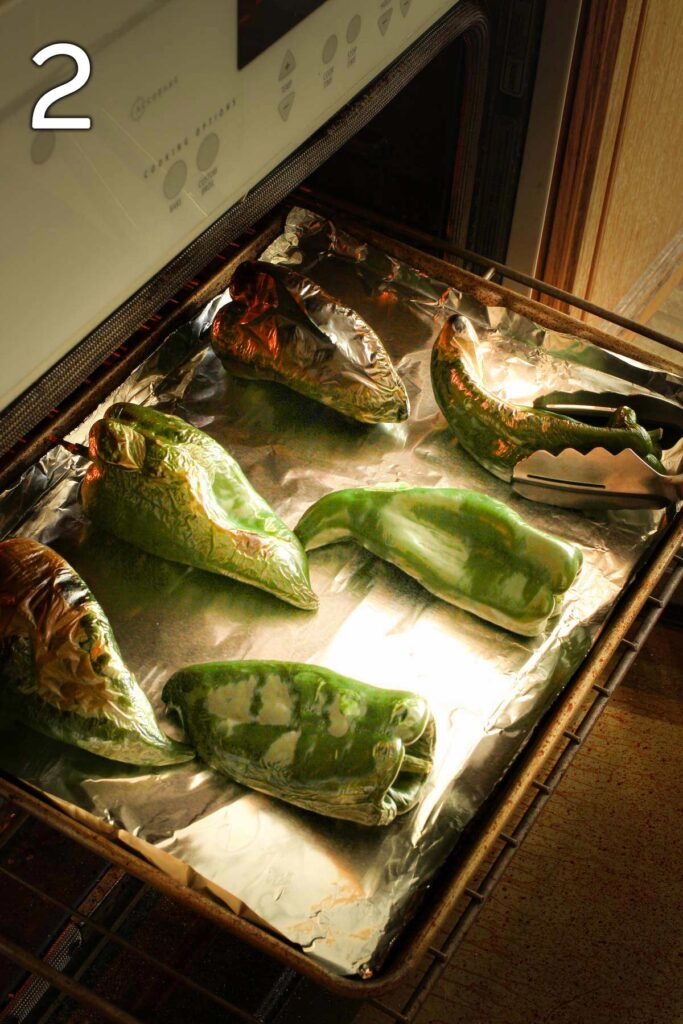 turning the poblanos that have been roasting under the broiler.