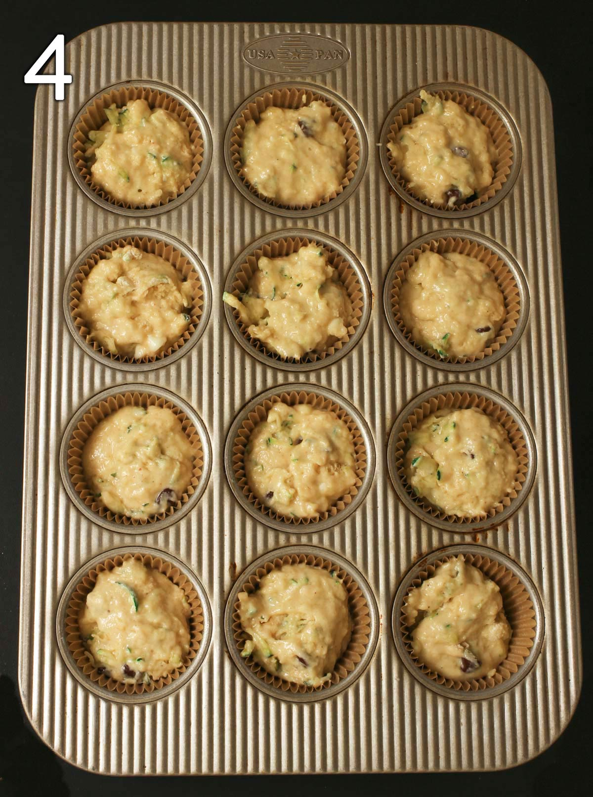 batter scooped into muffin tins.