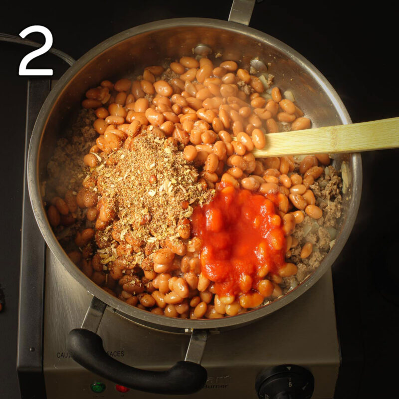 beans, sauce, and spices added to ground beef in the skillet.