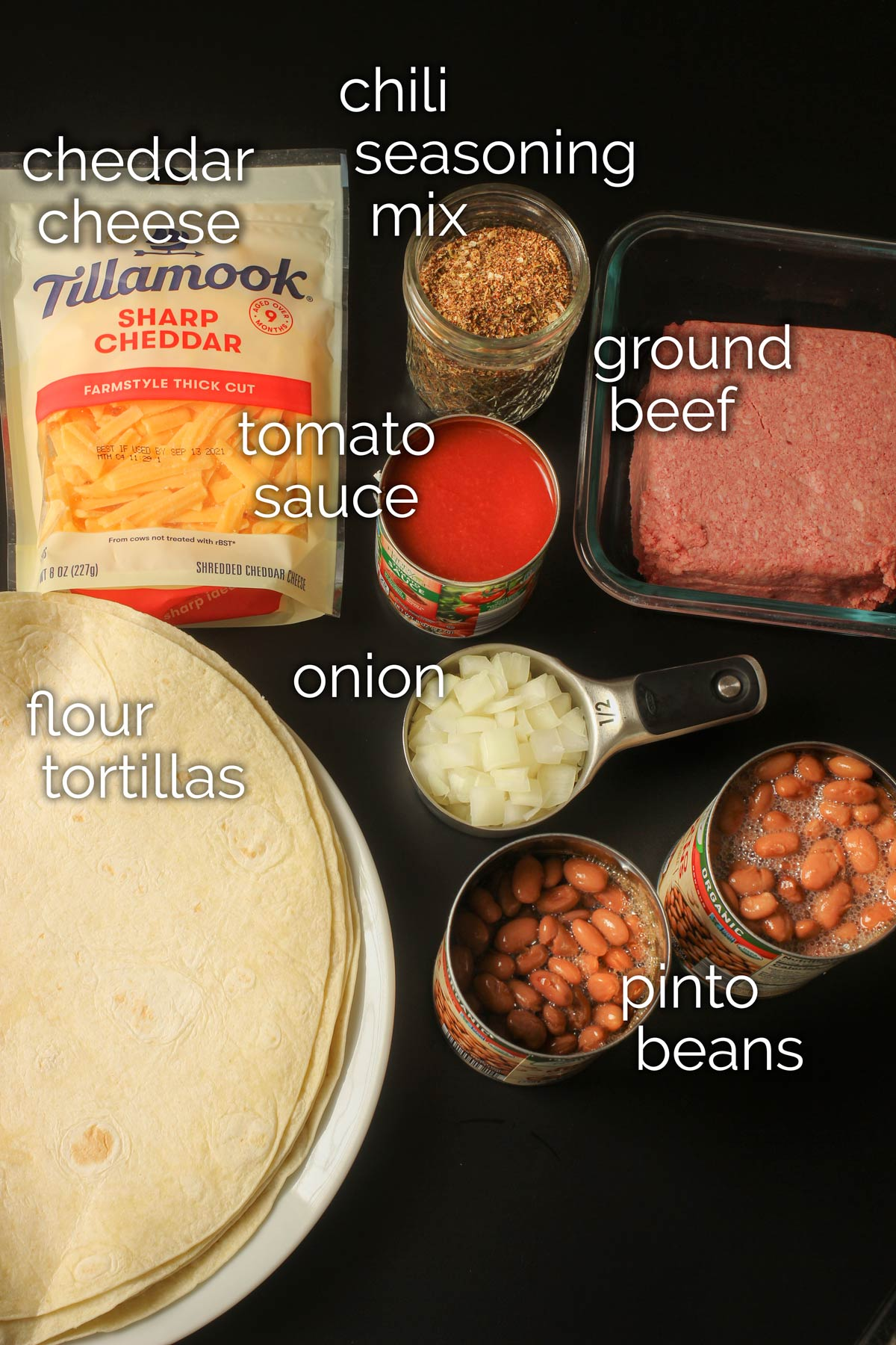 ingredients for chili cheese burritos laid out on tabletop.
