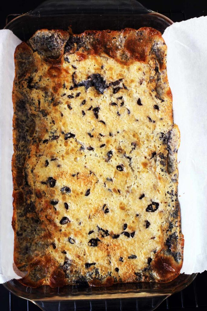 magic bars baked in glass pan lined with parchment.