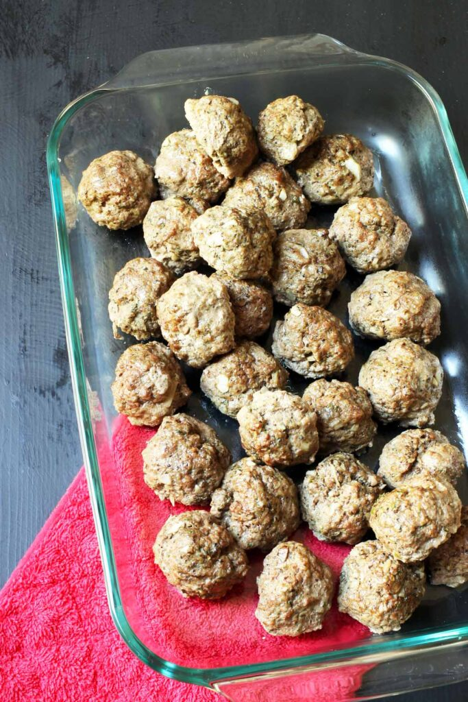 baked meatballs in a large baking dish.