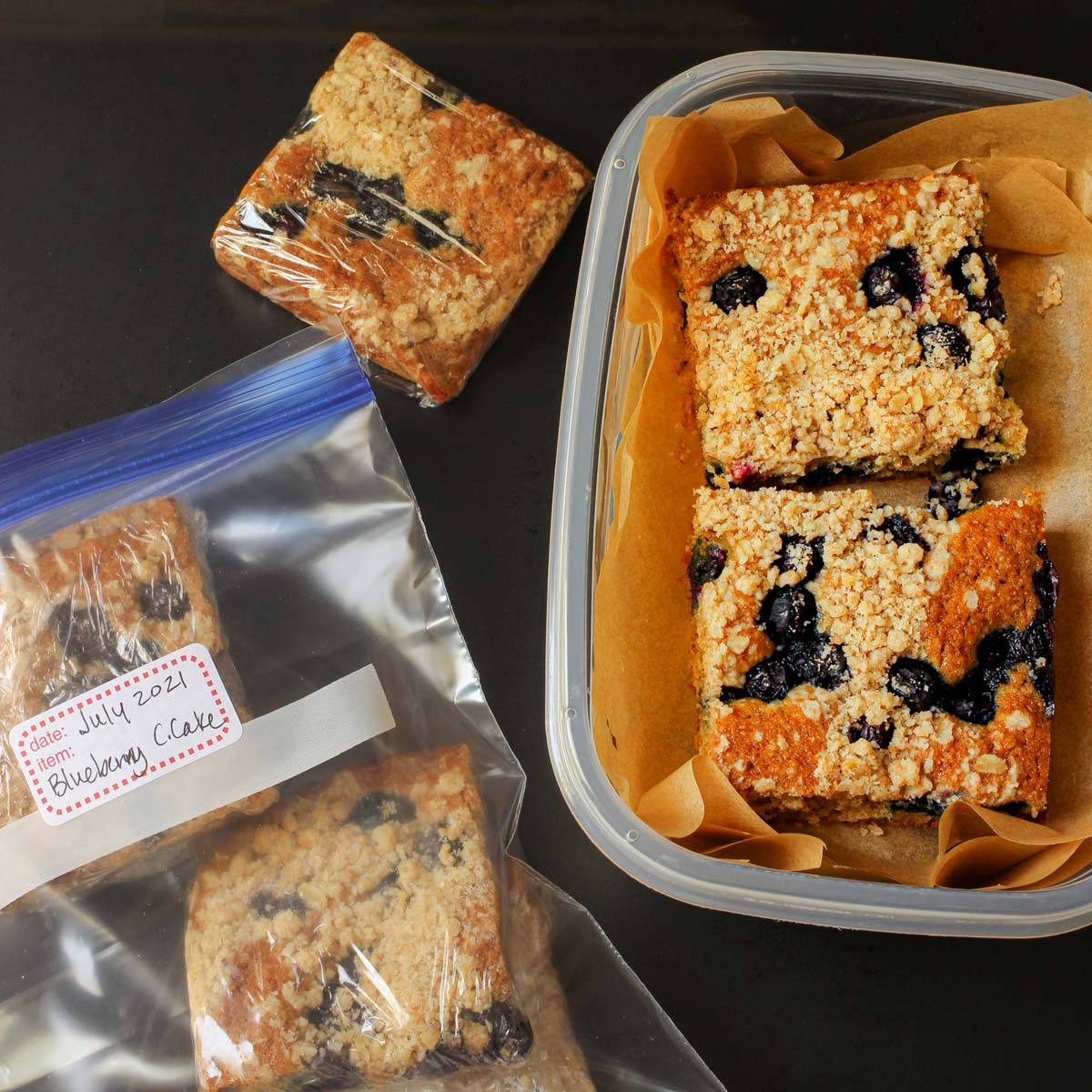 coffee cake packed in plastic container with parchment as well as individual squares wrapped in plastic.