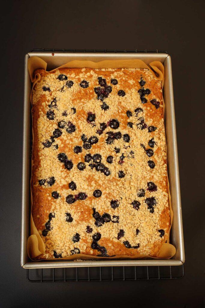 baked blueberry lemon coffee cake in baking dish.