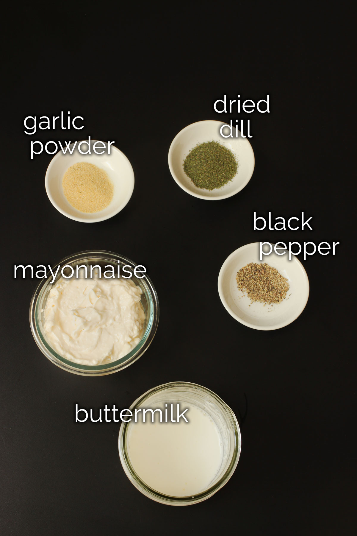 ingredients for buttermilk dressing laid out on tabletop.