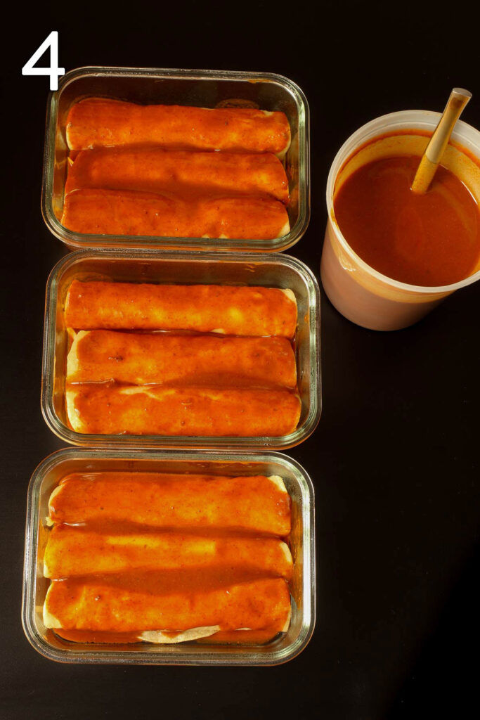 three small pans of assembled and sauced enchiladas.