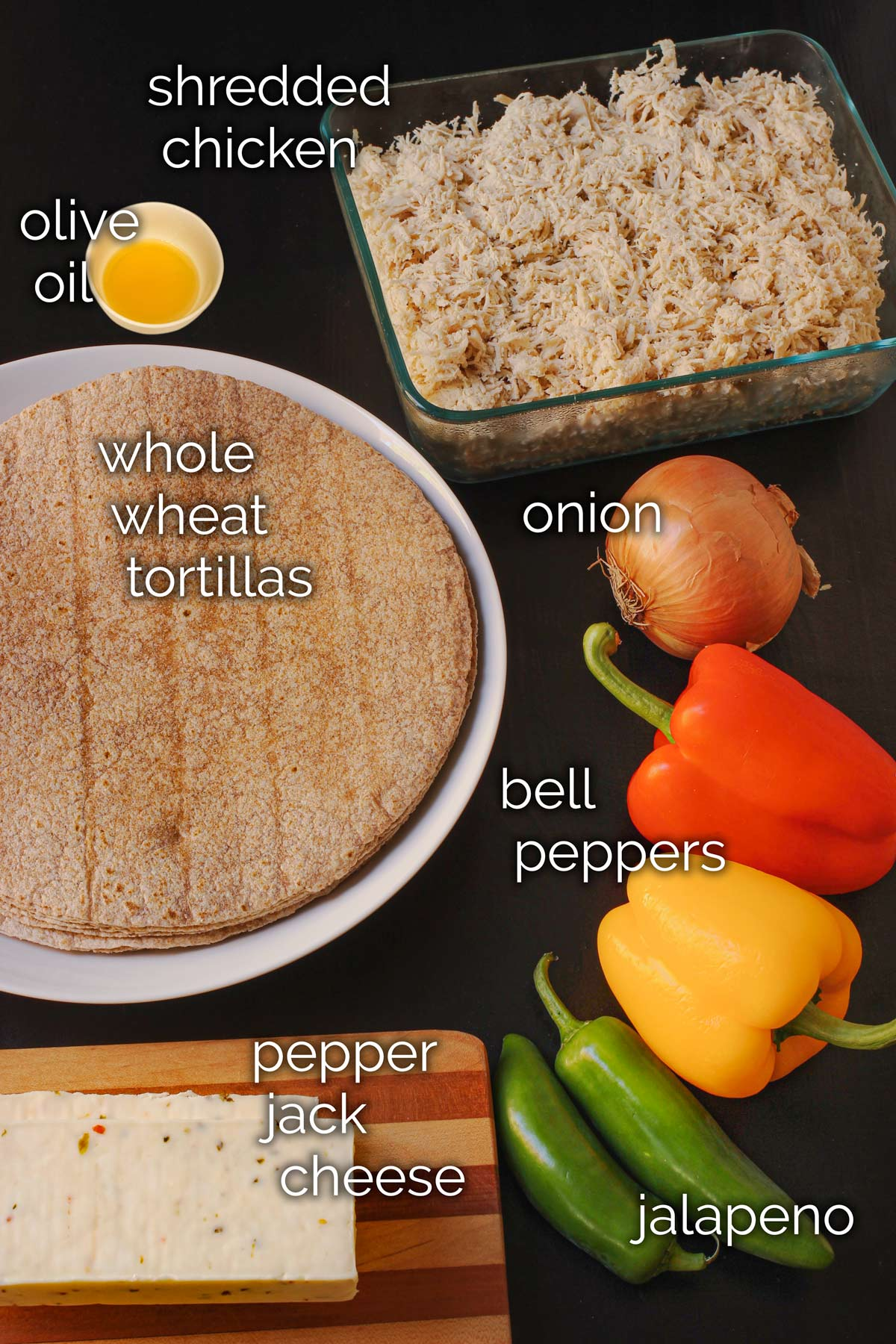 ingredients for chicken fajita burritos laid out on table top.