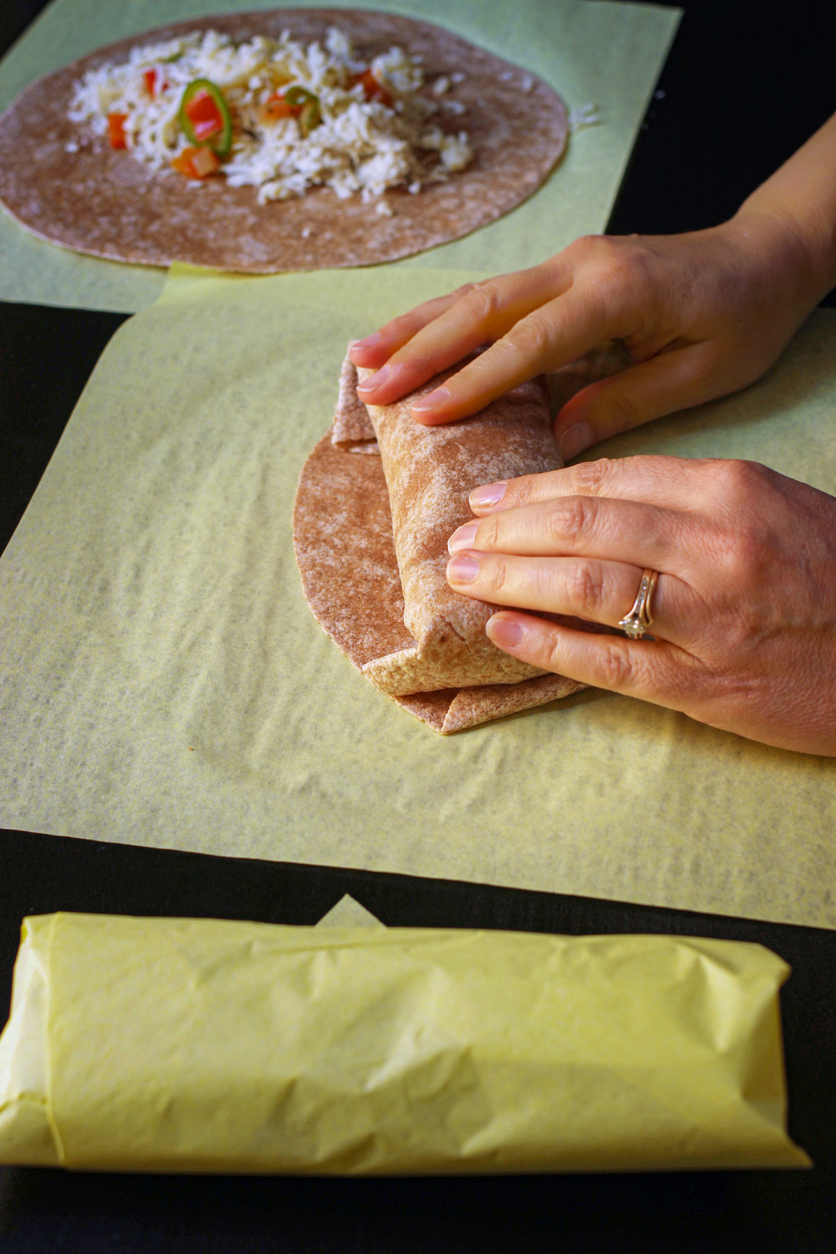 hand rolling the burrito the rest of the way.