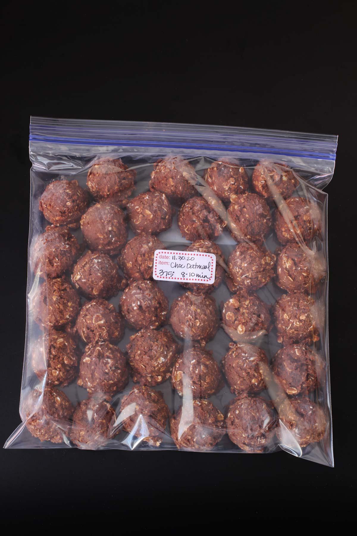 frozen cookie dough balls in a ziptop freezer bag.