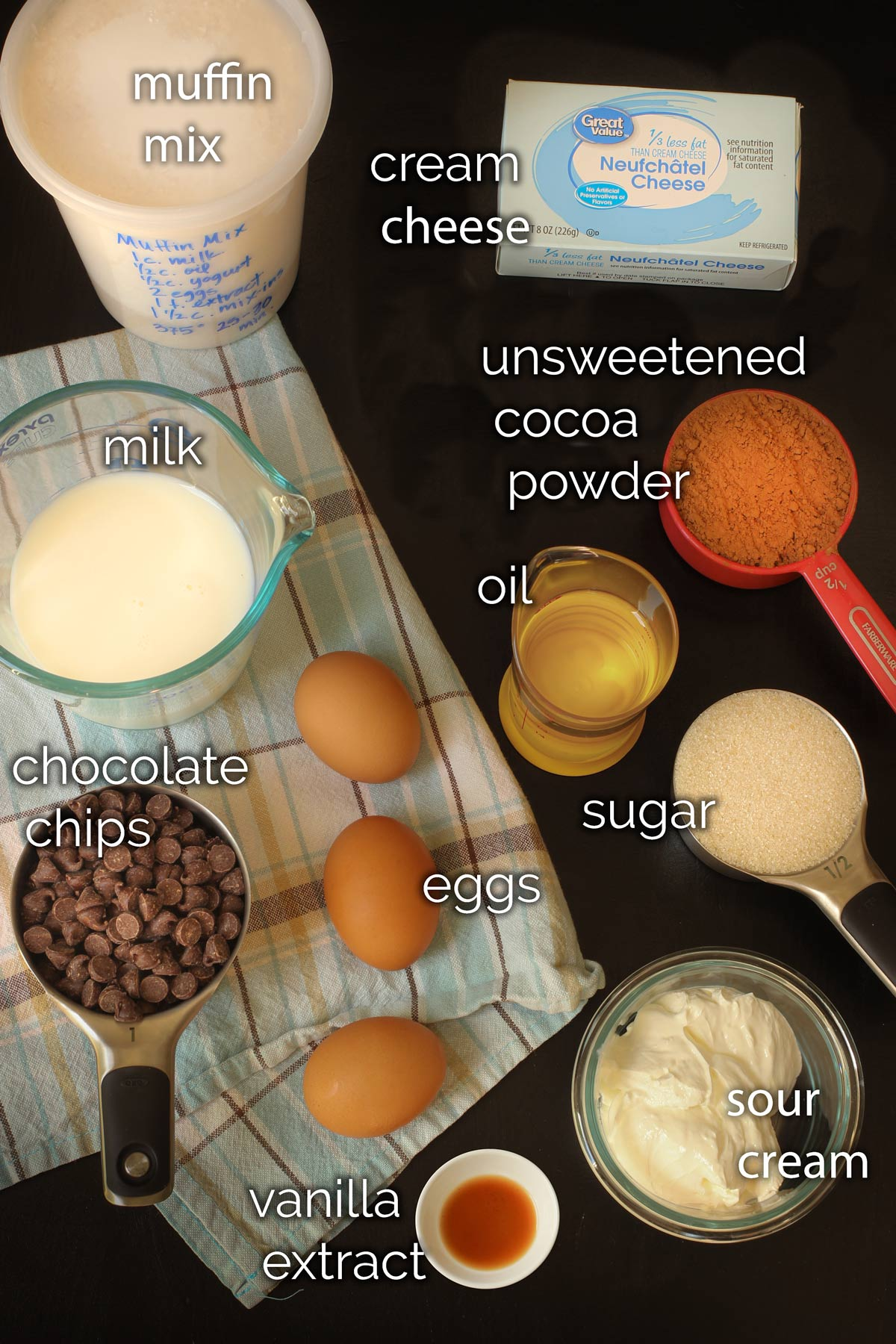 ingredients for chocolate cream cheese muffins laid out on table.