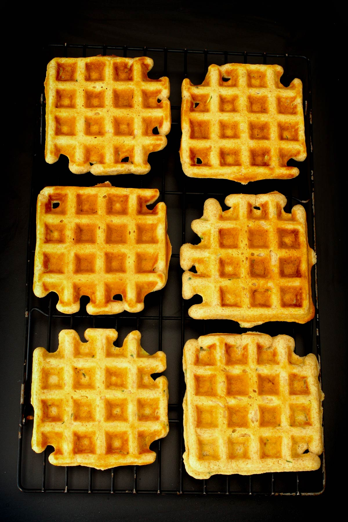 cinnamon waffles cooling on wire rack.