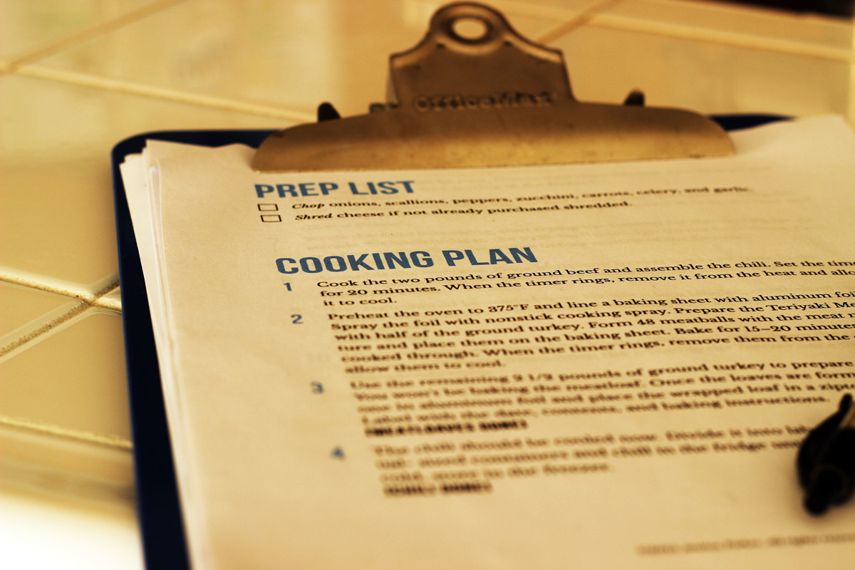 freezer meal cooking plan on blue clipboard.