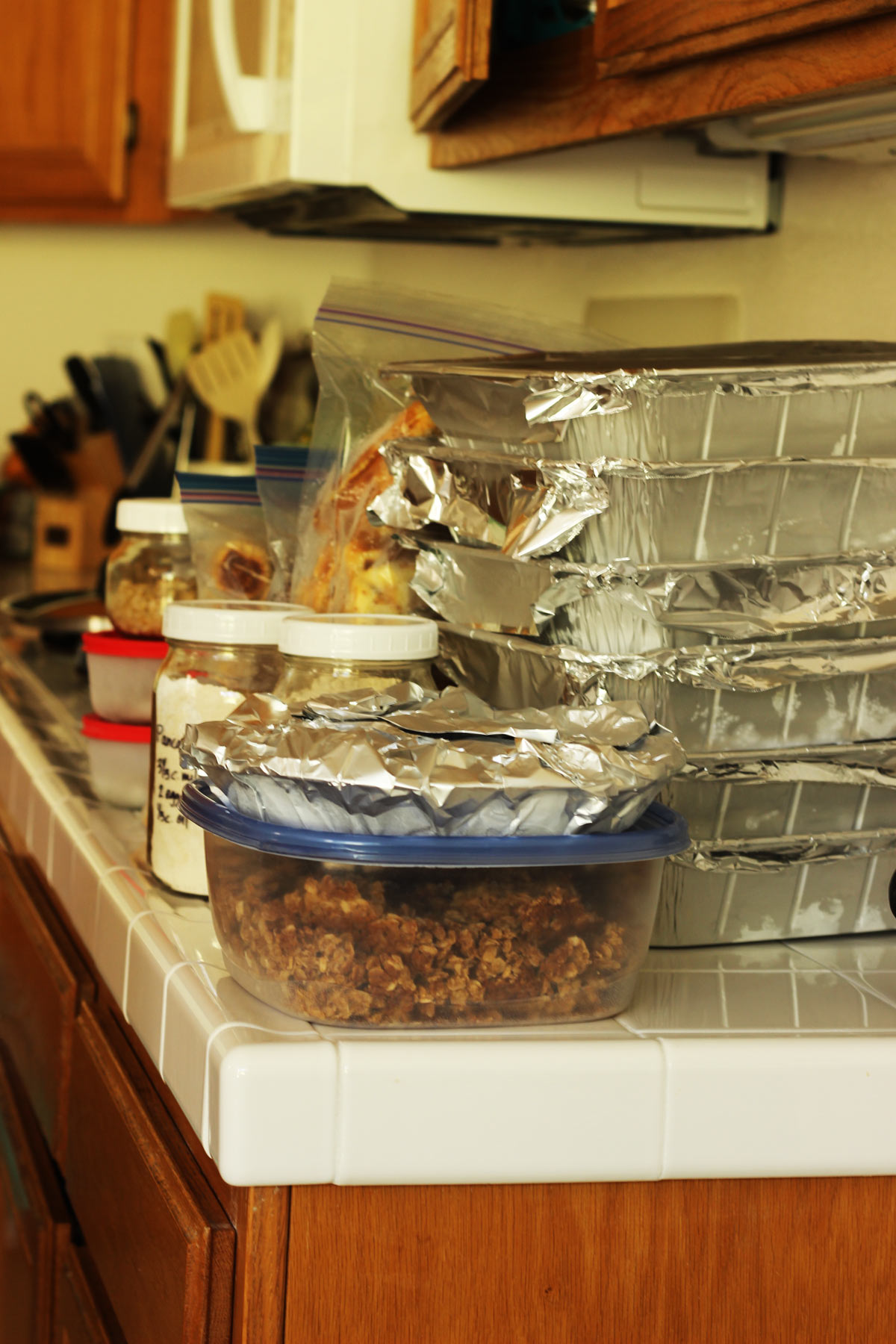 stacks of freezer meals on kitchen counter ready to be frozen.