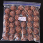frozen cookie dough balls in ziptop freezer bag.