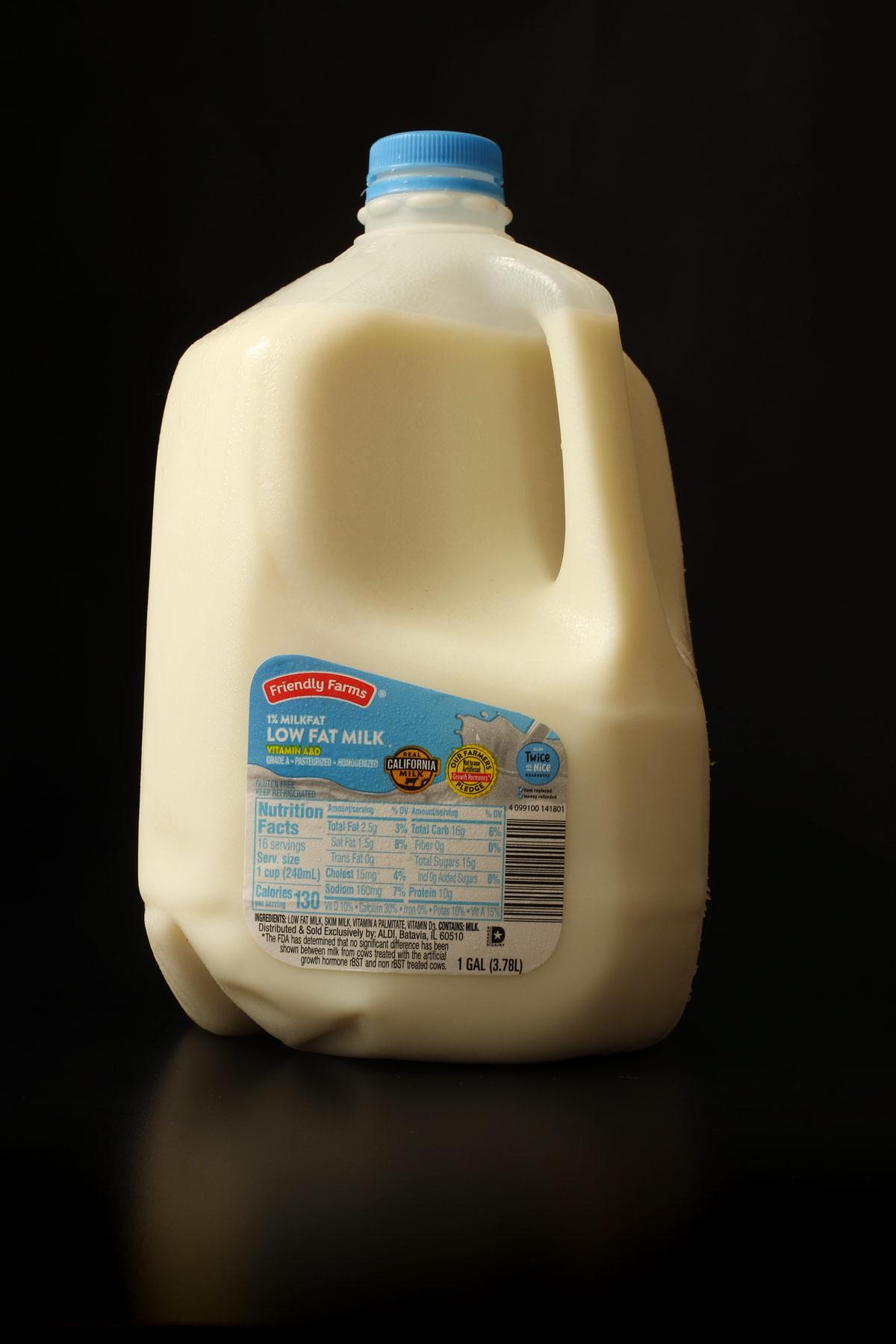 gallon of milk on black tabletop.