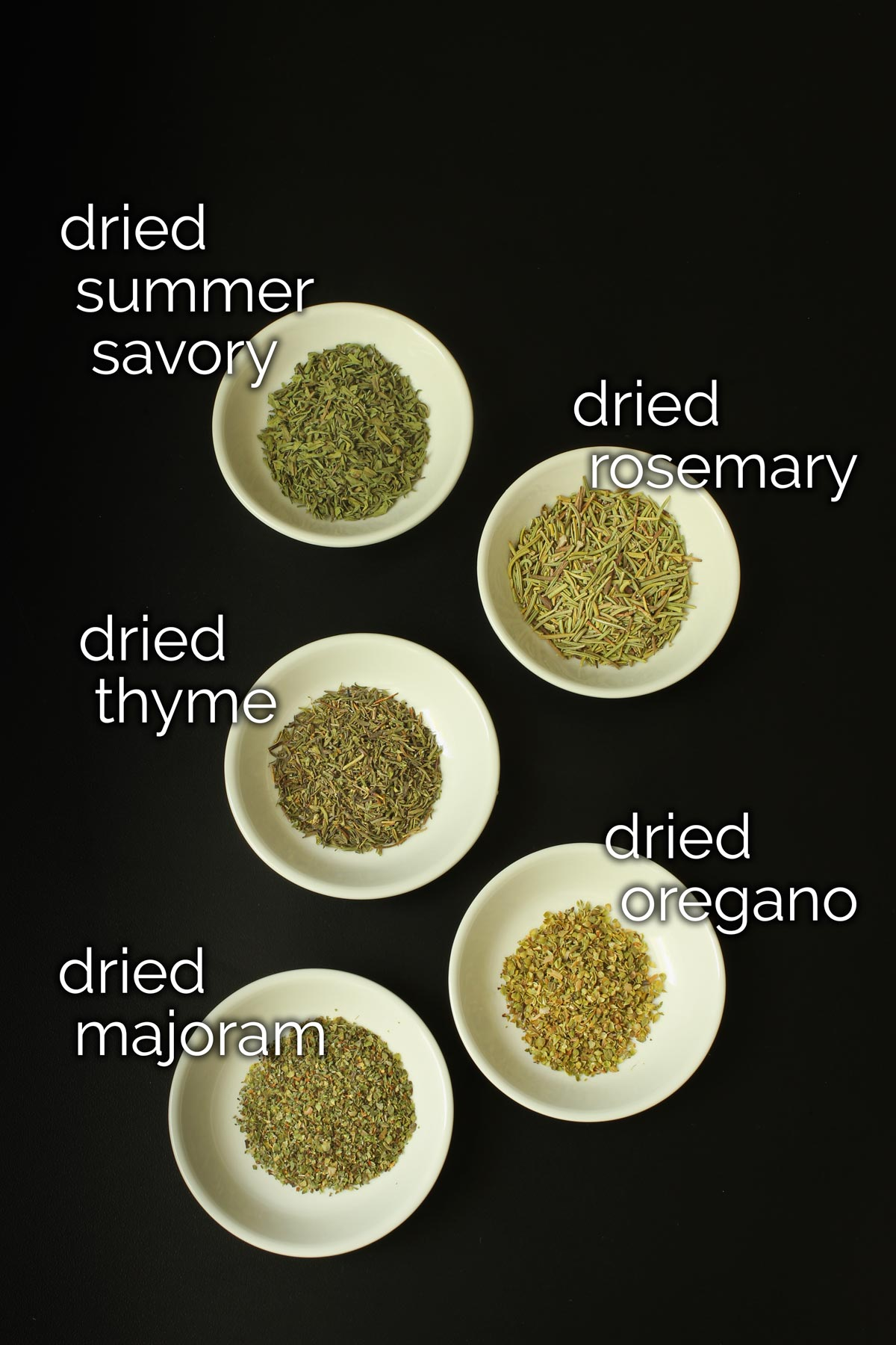 ingredients for homemade herbes de provence in small white dishes.
