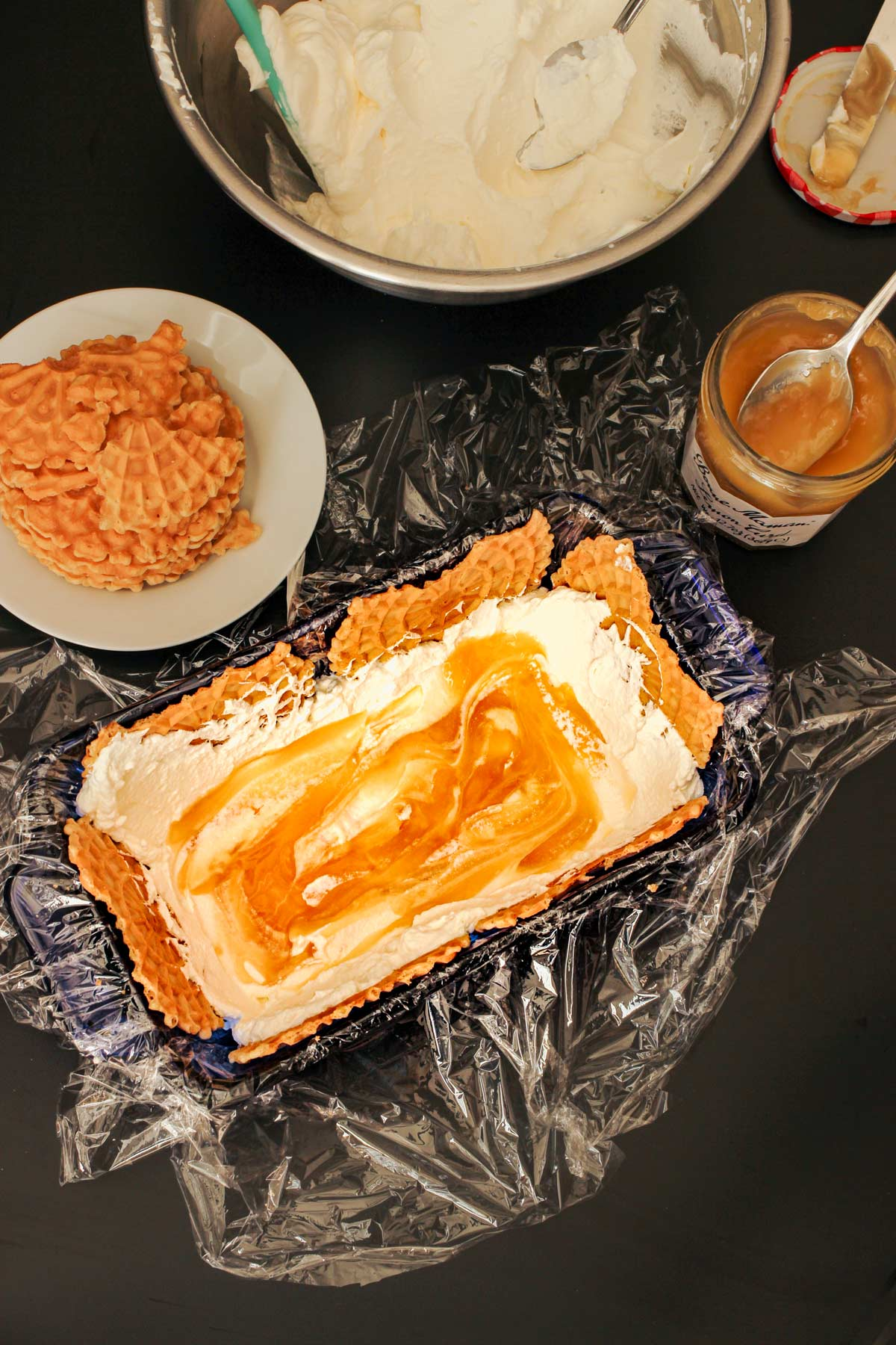 curd spread over the layer of whipped cream in loaf pan.