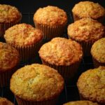 lemon poppy seed muffins cooling on a rack.