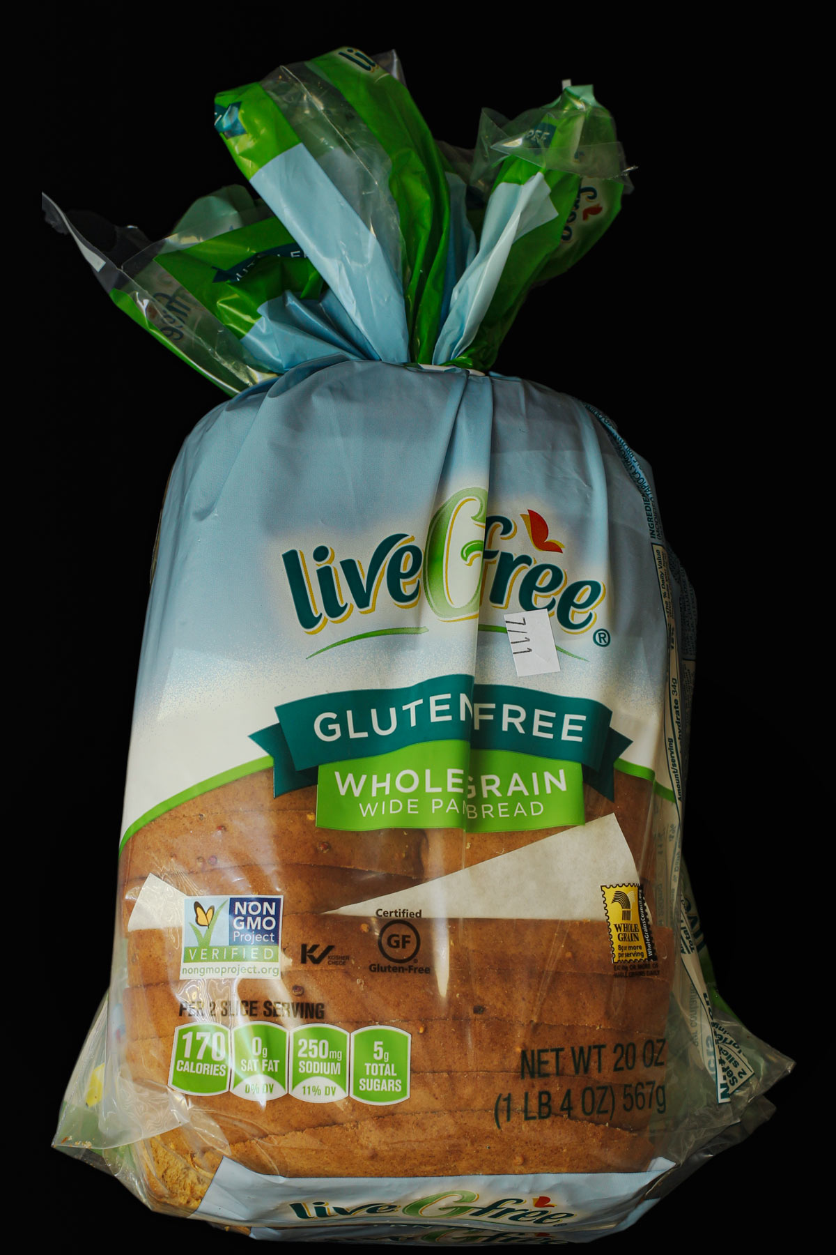 bread repackaged in original bag but with slices separated by patty papers.