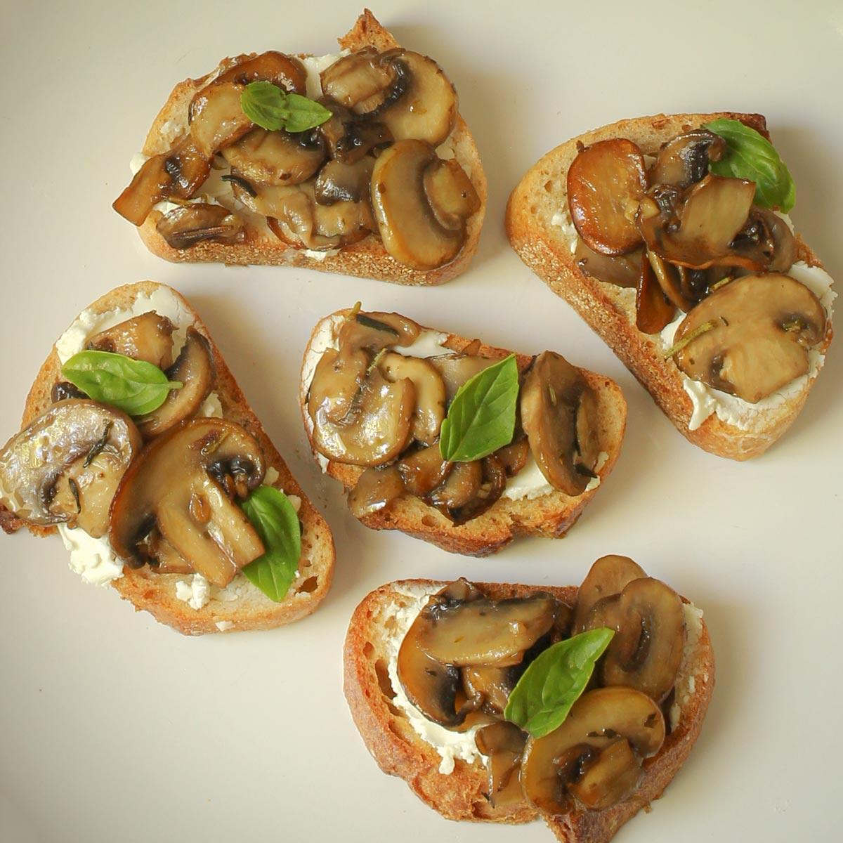 sauteed mushrooms on crostini with goat cheese.