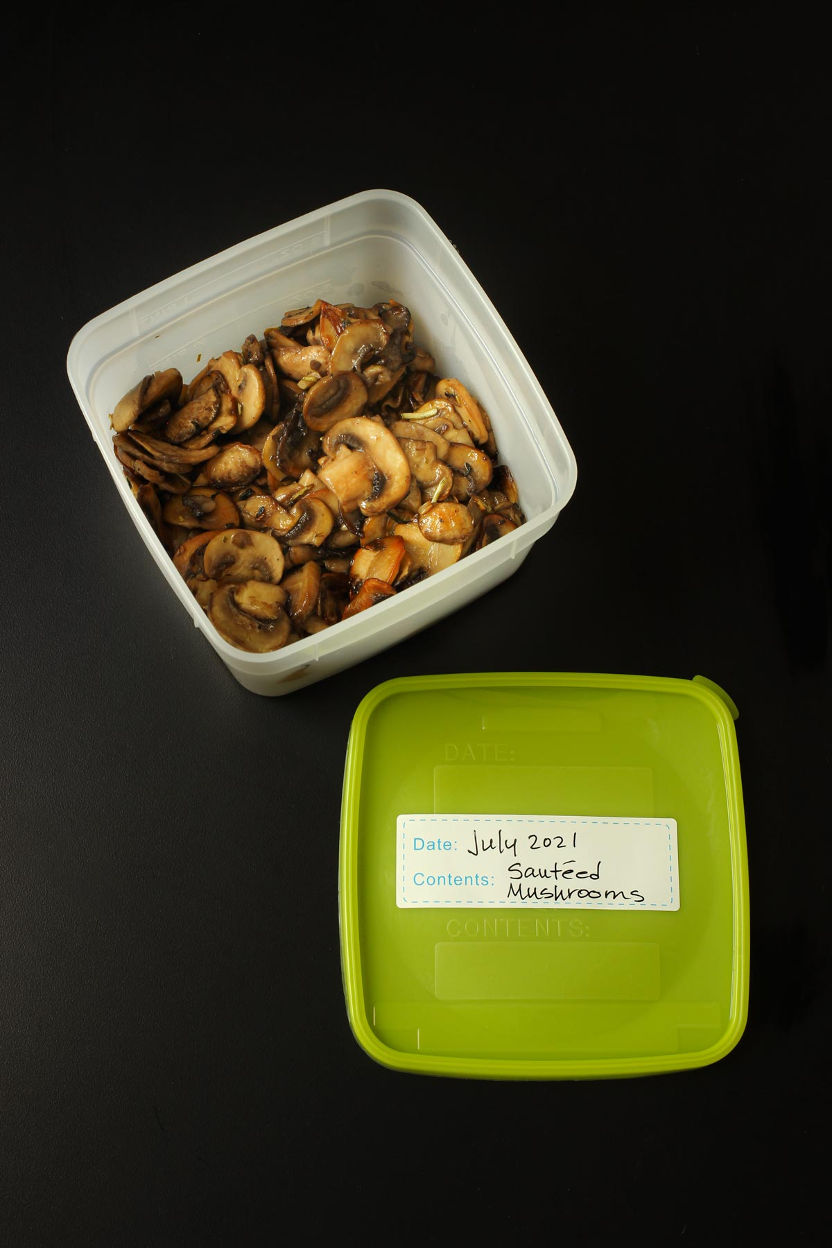 sauteed mushrooms in freezer-safe container with a labeled lid.