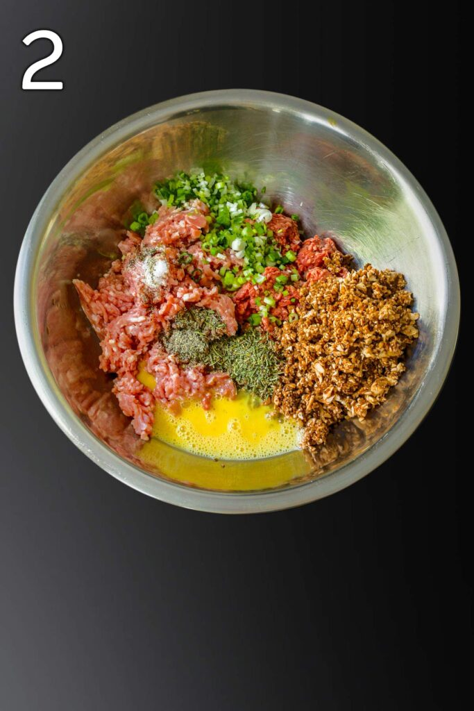 all the ingredients added to a large metal mixing bowl.