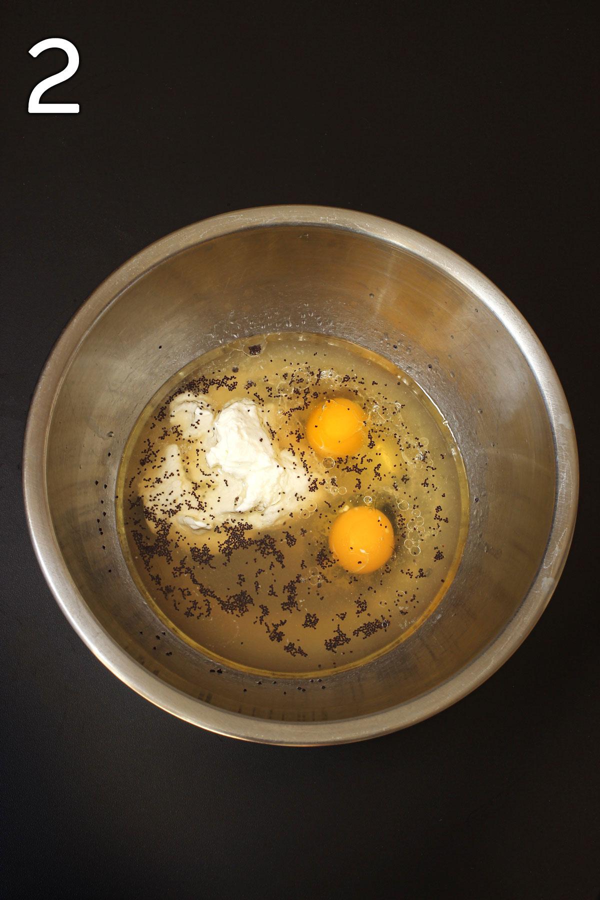 placing all liquid ingredients in metal mixing bowl.