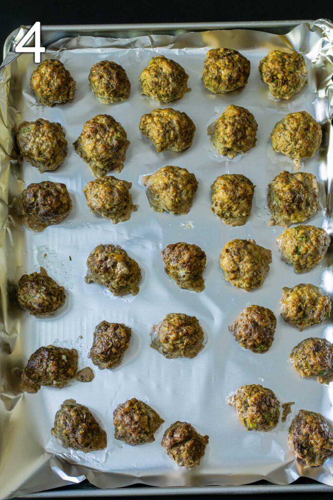 baked meatballs on the baking sheet.