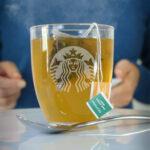 glass mug of medicine ball tea with steam rising.