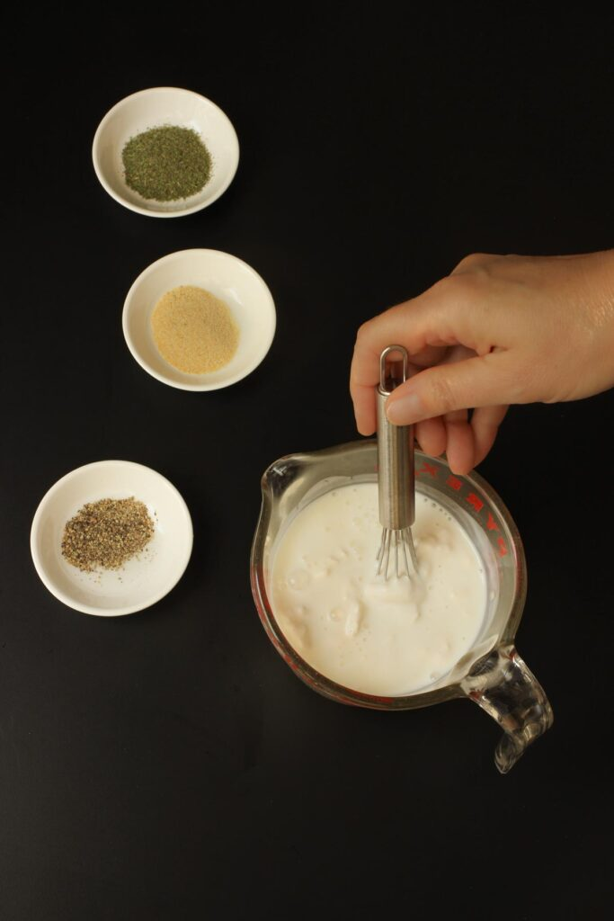 whisking together the mayonnaise and buttermilk in a small glass pitcher.