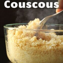 PIN image of hand forking cooked couscous in glass bowl.