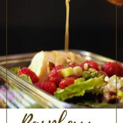 PIN image of raspberry vinaigrette pouring onto salad.